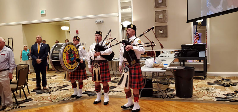 The Palm Beach County Fire Rescue Pipe and Drum perform at the ceremony