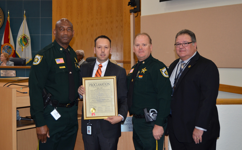 PBSO Major Alphonso Starling, Vice Mayor Dave Kerner, PBSO Major Michael Devoter, and Colonel Antonio Araujo.