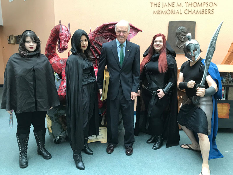 Commissioner Valeche posed with Game of Thrones-costumed library staff and their dragon float book cart