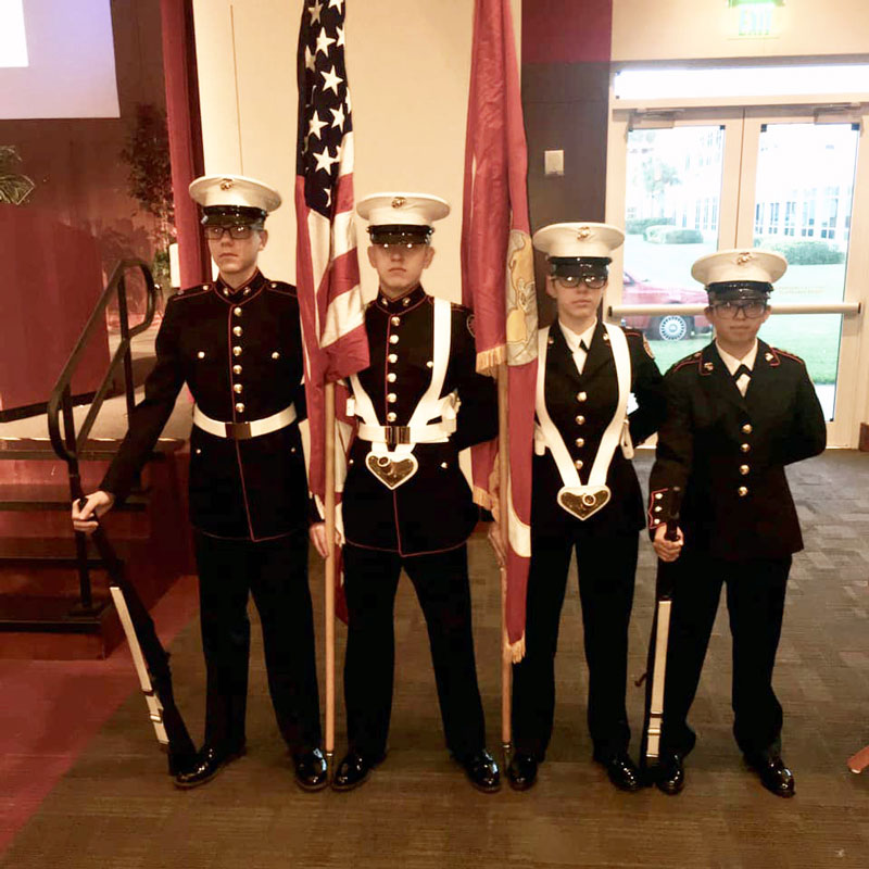 Local students serve as honor guards at the event recognizing teachers.