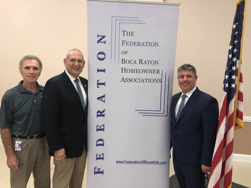 Pictured here (l to r) are School Board Chair Frank Barbieri, Commissioner Weinroth and Brian Stenberg.