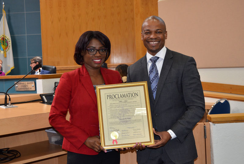 Mayor Bernard presenting  a proclamation to Ms. Marcda Hilaire