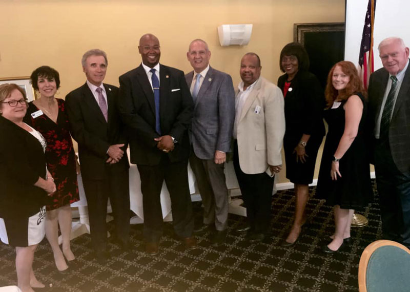 Commissioner Weinroth (center) joins Dr. Donald Fennoy (on his right) and other attendees at the luncheon.