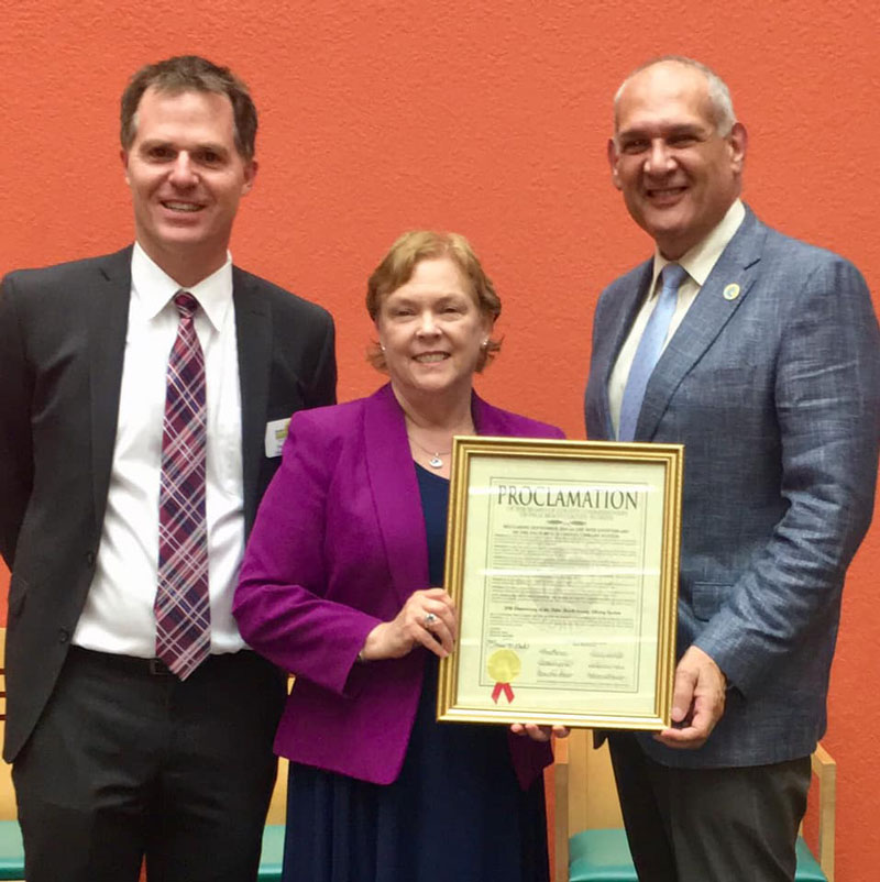 Pictured here (l to r) are Library System Director Douglas Crane, Commissioner Mary Lou Berger and Commissioner Robert S. Weinroth.
