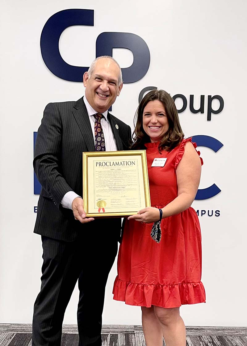Pictured here are (l to r): Vice Mayor Robert Weinroth and Boca Raton Junior League President Jamie Sauer.