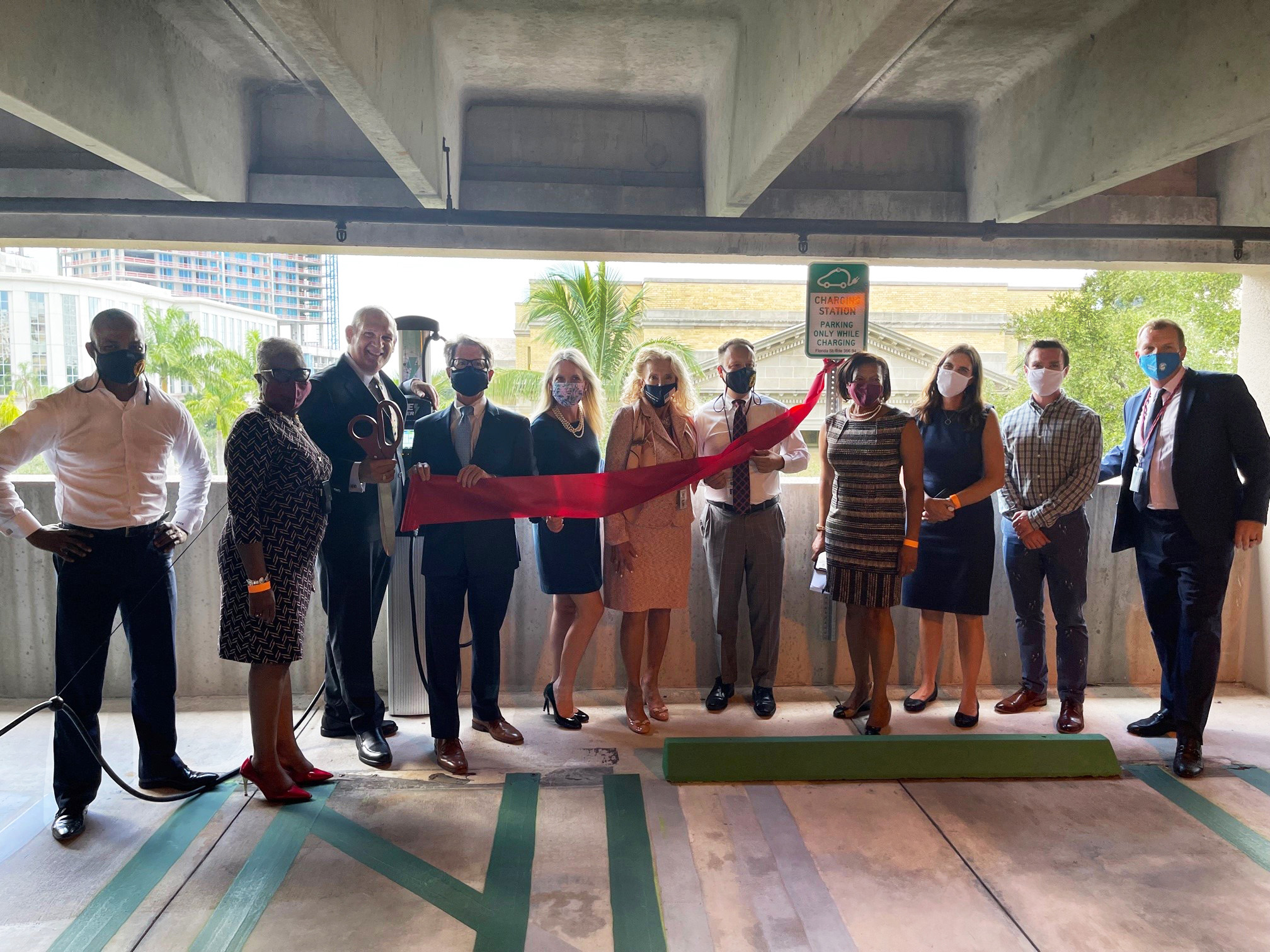 Commissioners and Administrators pose at charging stations