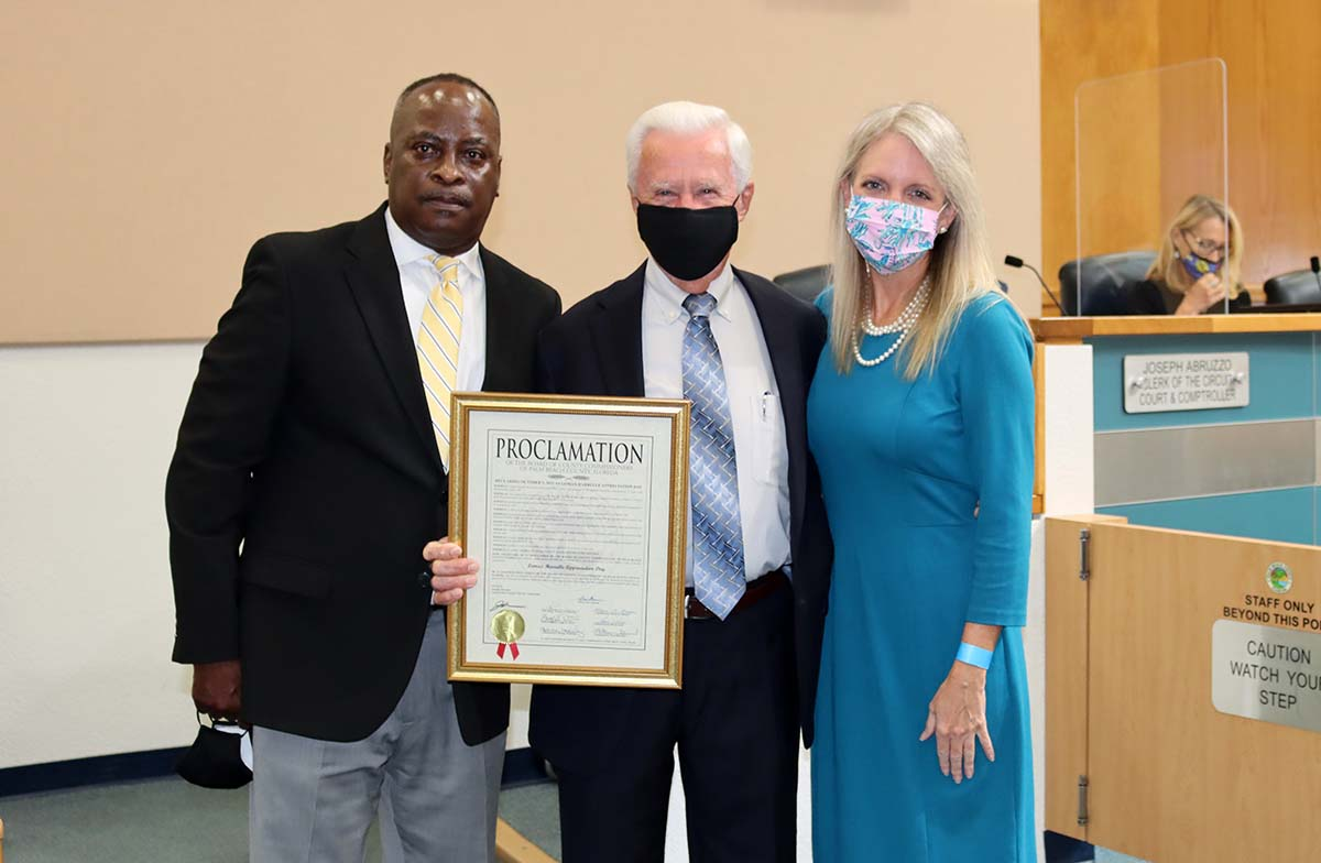 Pictured here (l to r) are Belle Glade Mayor Steve Wilson, Lomax Harrelle and Commissioner Melissa McKinlay.