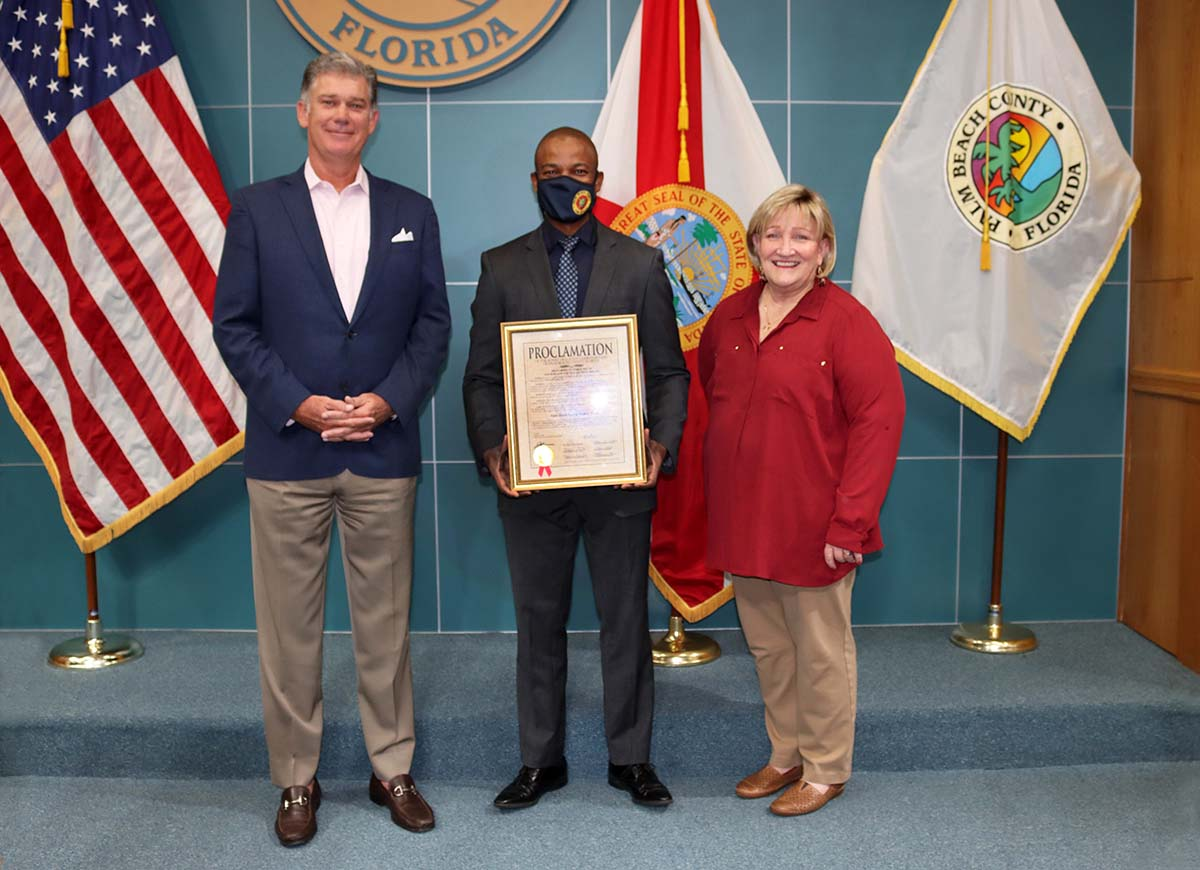 Historical Society of Palm Beach County President and CEO Jeremy Johnson,                             Commissioner Mack Bernard and Historical Society of Palm Beach County Chief Curator Debi Murray