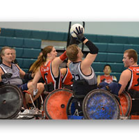 People on wheelchairs playing basketball