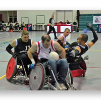 People on wheelchairs playing rugby