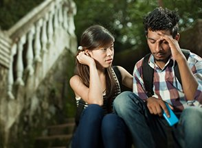 couple sitting on steps together
