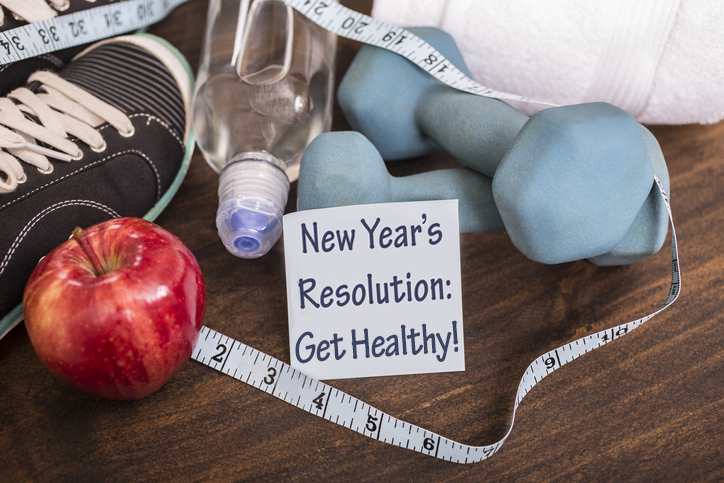 New years sign, apple, and tape measurer
