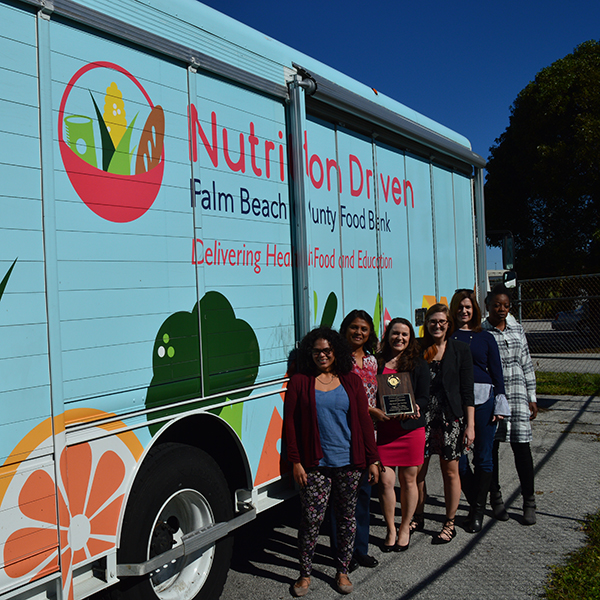food bank truck with people posing outside