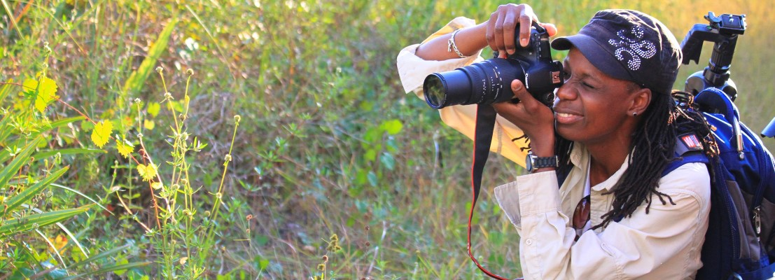 Person taking photos in a Palm Beach County Natural Area