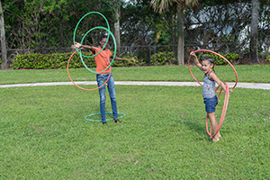 Two girls playing with hoola hoops