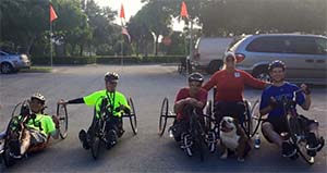 people handcycling