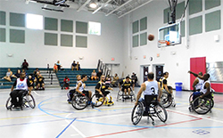 people playing basketball in wheelchairs